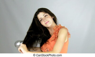 Beautiful female model drying hair