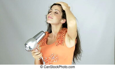 woman drying long hair slow motion