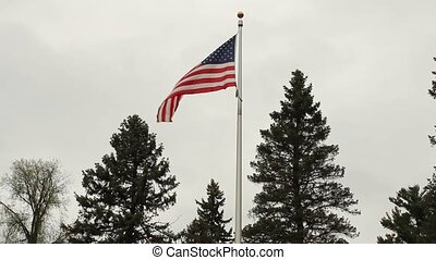 american flag - American flag blowing in the breeze on an...
