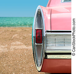 Pink Classic Car - Vintage pink car on the beach