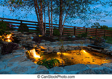 Garden pond - Decorative koi pond in a garden at night