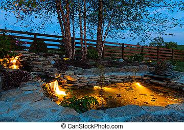 Garden pond - Decorative koi pond in a garden at night