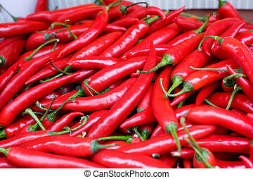 Fresh Hot Peppers - A bulk display of hot red peppers