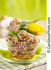 fresh cheese balls with oil and spices