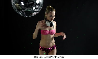 a sexy gogo dancer shot in a studio dancing and posing with...