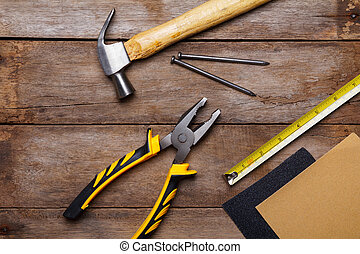 Construction instruments on wooden table - sandpaper,...