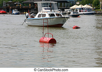 boat in the river, dirty river buoy for a boat