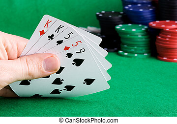 Two Pair - A poker hand with two pair and chips in the...