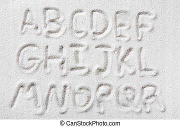 Sand Alphabet - First half of an upper case alphabet written...