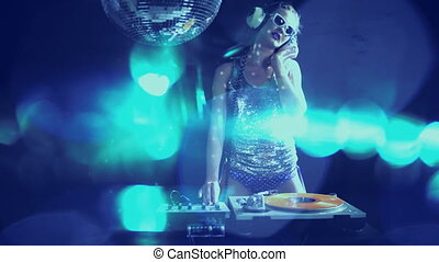 a sexy female dj dancing and playing records with disco...