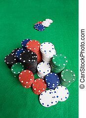 Poker Chips - A large stack of poker chips on a green felt