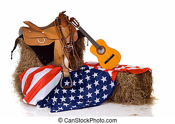 Fourth of July saddle and flag - Riding saddle on hay,...