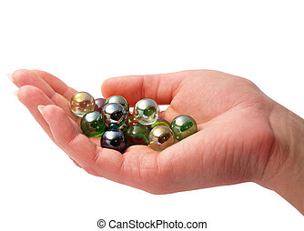 Handful of marbles - A woman\\\'s hand holding shiny glass...