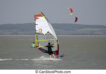 Austria, Neusiedler lake - wind and kite surfer on...