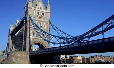 panning shot of tower bridge and london skyline, on a nice...
