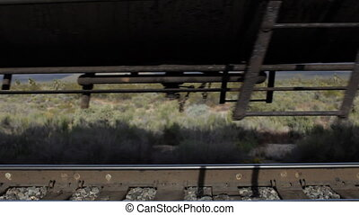a very long cargo train passing in america