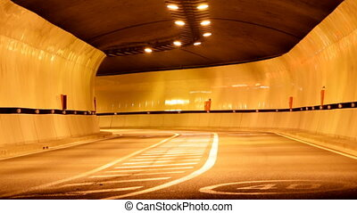 rush of night time traffic going under tunnel in timelapse...