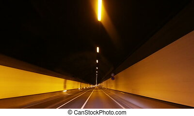 timelpase of driving through a tunnel with lights