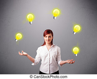 young lady standing and juggling with light bulbs -...