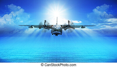 c123 military plane landing with blue sky sun shine...