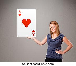 Beautifu woman holding a red heart ace - Beautifu young...