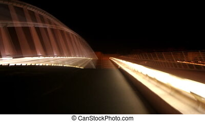 strange light pattern from a bridge at night in valencia, spain