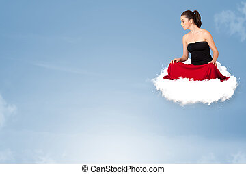Young woman sitting on cloud with copy space - Beautiful...