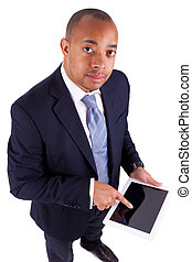 African American business man using a tactile tablet,...
