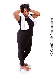 Disappointed  African American woman using a on isolated over white background - African people