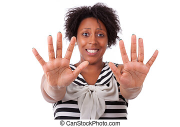 Young black woman showing her  hands palm - African people