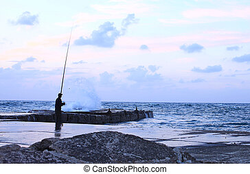 man fishing  in a storm