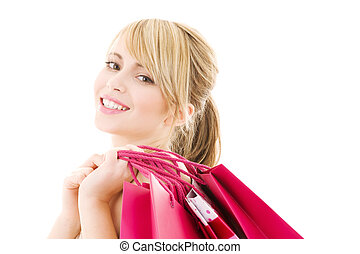 happy shopper - happy teenage girl with pink shopping bags