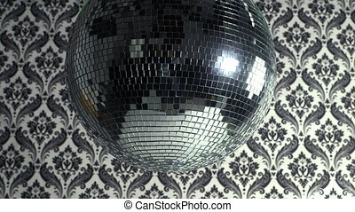 a funky discoball spinning with retro wallpaper background. perfect clip for club visuals or party/celebration