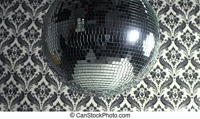 a funky discoball spinning with retro wallpaper background...
