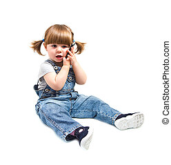 Cute little baby is talking on cell phone, isolated over...