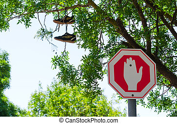Wrong way Stop sign and shoes on the tree - Stop traffic...