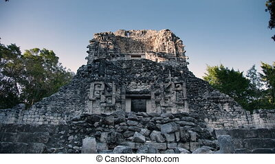 time-lapse of the mayan ruins at xpujil, mexico. the mayans...