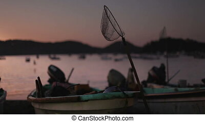 fishermen arriving at dawn in zihuatanejo with their catch to sell at the market, mexico
