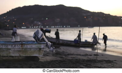 fishermen arriving at dawn in zihuatanejo with their catch...