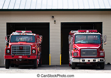 At the Ready - Two firetrucks parked and ready to roll
