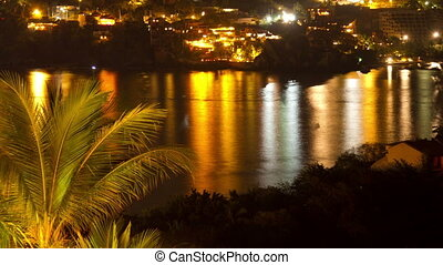 timelapse view at night of the coastline in zihuatanejo,...