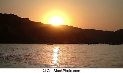 beautiful sunrise over the pacific ocean in zihuatanejo,...