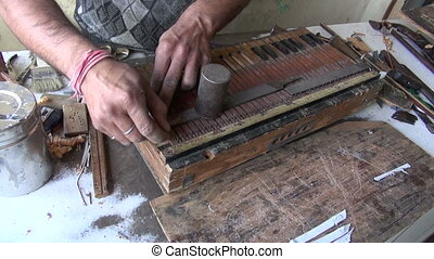 musical instrument repair work in shop, Jaipur, India