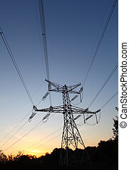 Electricity pylon on sunset - power energy