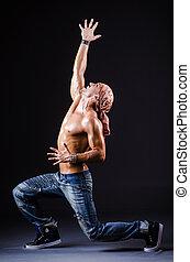 Dancer dancing in the dark studio