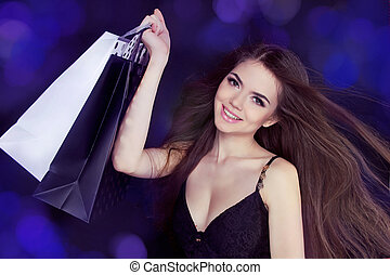 Happy Smiling beautiful girl with shopping bags at copy...