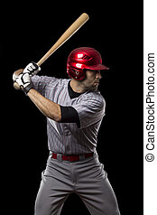 Baseball Player on a black background Studio Shot