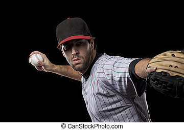 Baseball Player pitching a ball on a black background....