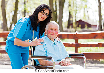 Retirement Home - Beautiful doctor, nurse in blue coat...