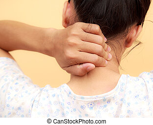 Woman neck pain - Woman holds a hand on pain neck